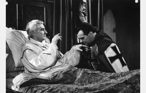 Kuolemansairas piispa (Urho Somersalmi) haluaa Olavi Gideoninpojasta (Tauno Palo) seuraajansa.